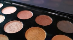 A professional make up palette, the shot is moving in a half circle Stock Footage