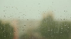 The raindrops flowing on glass windows in rainy weather Stock Footage