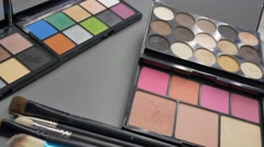 Footage of three make-up palettes and a professional  artist using one of them Stock Footage
