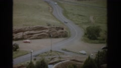 1959: highway with cars moving trees beside a deserted area COLORADO Stock Footage