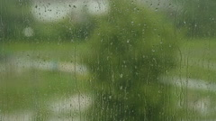 Raindrops on the window at the cloudy weather in the city Stock Footage