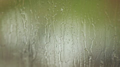 The raindrops flowing on glass windows in rainy weather 1 Stock Footage