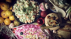 4k Christmas Food from Above Composition of Russian Traditional Dishes and Dolls Stock Footage