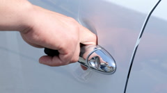 Man opens the door of the silver car, Stock Footage
