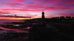 Watchet harbour lighthouse just before dawn. Stock Footage