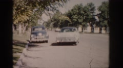 1959: old chevy car pulling up to the curb COLORADO Stock Footage