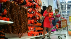 Mother and son are buying goods in the supermarket on Halloween, family Stock Footage