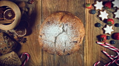 4k Christmas Food from Above Composition of Sugar Falling on Italian Panettone Stock Footage
