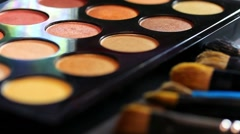 Footage of a make up palette, the shot is moving in a half circle Stock Footage