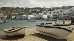 Two fishing boats on the beach in the town of chora, mykonos Stock Footage