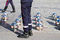 Firefighter or fireman helmets are seen on the floor during parade Stock Photos