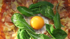 Margarita pizza topping with green spinach and raw egg yolk. Italian fusion food Stock Footage