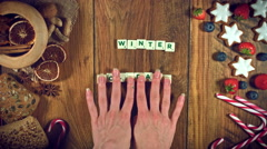"""4k Christmas Food from Above Composition of Scrabble """"Winter Holidays"""" Stock Footage"""