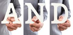 Hands holding letter text and word Stock Photos