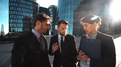 Businesspeople give phone. Your family calling Stock Footage