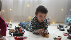 Little child playing with lots of colorful plastic toys indoor, building diff Stock Footage