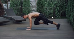 A young men,athlete doing mountain climber exercises in outdor Stock Footage