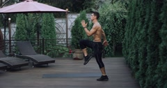 Male doing plyometrics exercise in home garden. Shot on Red Epic slow motion. Stock Footage