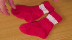 Children's wear. Children's red knitted socks Stock Footage