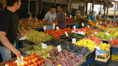 Fruit and vegetable stalls in the central market of athens, greece Stock Footage