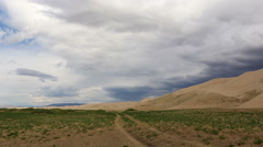 Storm clouds before rain in the Gobi Desert, dune Hongoryn, Mongolia. Full HD Stock Footage