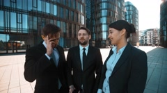 Businesspeople give phone. Big deal calling Stock Footage
