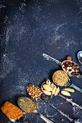 Aroma spice and dry herbs on the black table Stock Photos