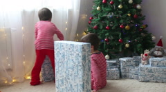 Cute boys, preschool children, opening presents on Christmas day Stock Footage