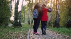 Teens walking make selfie outdoors in the autumn park. 1920x1080 Stock Footage