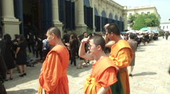 Thai King's Death Monks Wait in Lines Inside Grand Palace Stock Footage