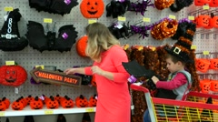 Family buys mask signs for doors on Halloween, family prepared for All Saints Stock Footage