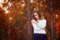 Beautiful woman in the autumn forest. Young brunette girl Stock Photos