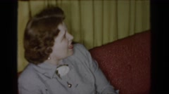 1965: people sitting in a room talking and smiling SAINT LOUIS MISSOURI Stock Footage