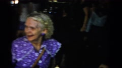 1965: old woman in part enjoying talking family SAINT LOUIS MISSOURI Stock Footage