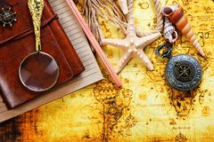 Marine still life spyglass and world map on wooden background Stock Photos