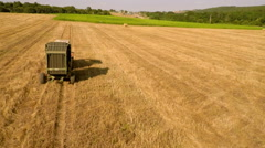 Aerial Footage of Tractor with Baling Press Stock Footage
