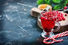 Cranberry drink and berries Stock Photos