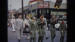 1965: parade through small town with boy scouts and marching band SAINT LOUIS Arkistovideo