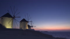 Beautiful sunset at the windmills on the famous island of mykonos, greece Stock Footage