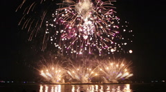 Beautiful fireworks from boats on sea Stock Footage