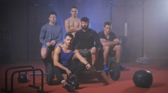 Team of crossfit athletes looking into the camera and wiggles his head Stock Footage