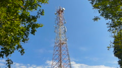 Communications tower timelapse with sky and cloud background. Antenna tower b Stock Footage