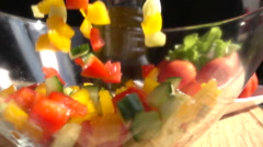 Chopped Vegetables Mix Falls in Glass Bowl Slow Motion Stock Footage