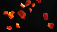 Slow Motion Chopped Red Bell Pepper falls Stock Footage