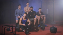 Group of strong men at the gym gives thumbs up and say yes Stock Footage