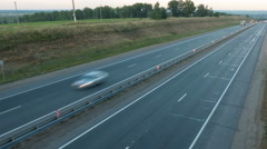 Cars moving on the highway. View from above. Sunset Dawn. Dusk. twilight. tim Stock Footage