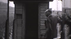 Man Runs to Outhouse Outdoor Toilet Privy 1930s Vintage Film Home Movie 10266 Stock Footage