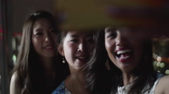 Beautiful Japanese and International girls at party taking seflies city view. Stock Footage