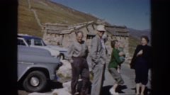 1959: a group of tourists standing on the top of a hill in the breeze COLORADO Stock Footage