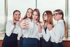 Five business women make selfie against the window Stock Photos